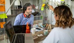 colleagues-discussing-about-business-strategy-at-modern-office-picture-id1225020698