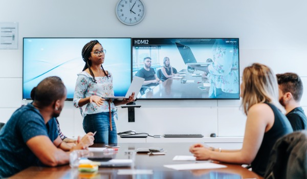colleagues-discussing-in-meeting-room-during-video-conference-picture-id1211197186