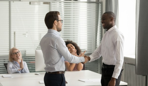 confident-executive-shaking-hand-of-successful-african-american-picture-id1263022868
