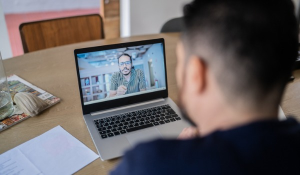 mature-man-doing-a-business-video-call-at-home-picture-id1332111900