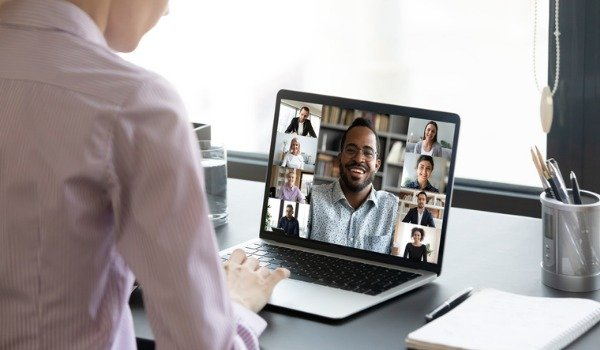 woman-worker-engaged-in-online-team-briefing-on-computer-picture-id1222279363